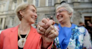Dr Ann Louise Gilligan and her partner Senator Katherine Zappone on the steps of Leinster House as the Marriage Bill 2015 passed through all stages in the Houses of the Oireachtas. Photograph: Alan Betson