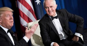 Australia's prime minister Malcolm Turnbull listens to US president Donald Trump  before a meeting on board the USS Intrepid aircraft carrier in  New York on May 4th. Photograph:  Brendan Smialowski/AFP/Getty Images