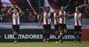 Estudiantes players, includingJuan Sebastián Verón, celebrate a goal during their Copa Libertadores clash with Botafogo. Juan Otero (centre) was targeted by  Federico Allende in their Copa Argentina defeat to Sport Club Pacifico. Photograph: Juan Mabromata/Afp