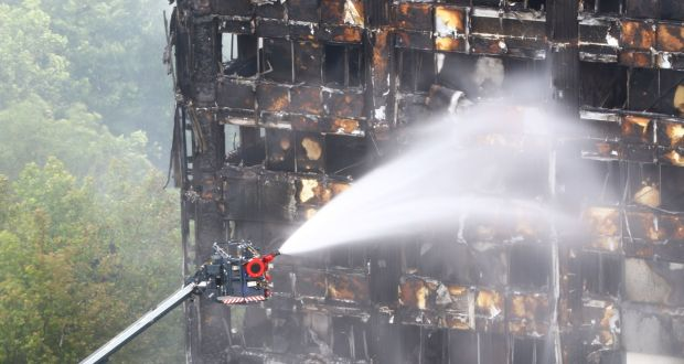 London fire woman posted live video from inside burning tower water is sprayed on grenfell tower in west london after a fire engulfed the 24 sciox Choice Image