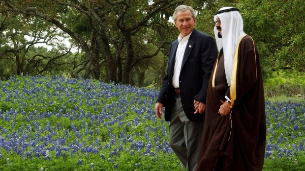 Taking it handy: former American president George W Bush escorts Saudi Crown Prince Abdullah. Photograph: Rod Aydelotte-Pool/Getty Images