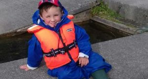 Harry O'Toole, Jnr, after a fine day's fishing on  Lough Corrib with his father