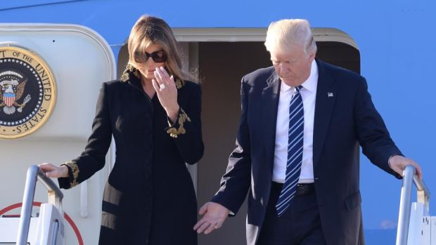 Brush-off: Melania Trump apparently avoids her husband's hand getting off Air Force One in Rome. Thwarted, he retaliated by patting her on the bottom. Photograph: Filippo Monteforte/AFP/Getty