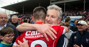 Kieran Kingston celebrates with his son Shane following the Munster quarter-final win over Tipperary at Thurles. Photograph: Cathal Noonan/Inpho