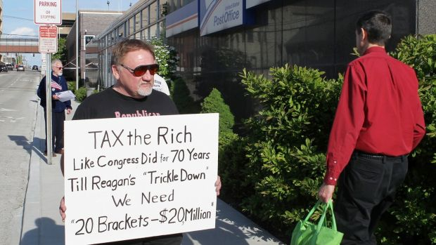 James Hodgkinson, who has been identified as the shooter of Steve Scalise, protests outside of the United States Post Office in Belleville, Illinois, in this April 2012 image. File photograph: Derik Holtmann/Belleville News-Democrat, via AP