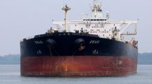 A Panamanian-flagged  oil tanker  anchored 14km south of Singapore. Traders are again hiring oil tankers to store unsold crude while they wait for higher prices. Photograph: Reuters