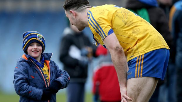 Neil Collins greets a young Roscommon fan. Photograph: Inpho