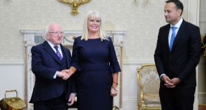 Mary Mitchell O'Connor receiving her seal of office from  President Michael D Higgins. Taoiseach Leo Varadkar looks on. Photograph: Dave Meehan/The Irish Times