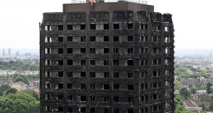 Thirty people have been confirmed dead and dozens still missing after the 24-storey residential Grenfell Tower block in London was engulfed in flames in the early hours of Wednesday morning. Photograph: Carl Court/Getty Images