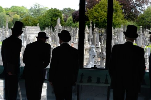 Performers waiting for the start of  the re-enactment of Paddy Dignam's funeral at Glasnevin. Photograph: Cyril Byrne / The Irish Times