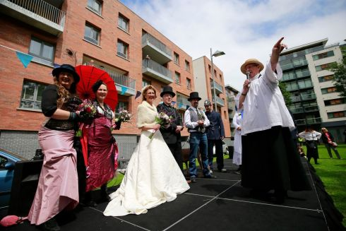 "Scene from ""Bloomsday In The Monto"",  including a mock wedding, organised by the North Inner City Folklore Project at Liberty House Park on Foley Street, Dublin 1. Priest played by Joe Dowling during the ceremony and  'Groom' Former Lord Mayor & Councillor Christy Burke with Bride Connie Murphy  Photograph: Nick Bradshaw / The Irish Times"