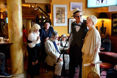 The scene at Fitzgerald's Sandycove as Nora Connolly and Tom Fitzgerald celebrate Bloomsday with a song.  Photograph: Cyril Byrne / The Irish Times