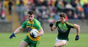 Donegal's Patrick McBrearty stretches away from Conor Hamill of Antrim during the Ulster GAA Senior Football Championship Quarter-Final.  Photograph: John McIlwaine/Presseye