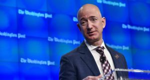 Amazon founder Jeff Bezos: appears to view the retail future as more nuanced than mere couch-bound shoppers ordering everything online.  Photograph: Mandel Ngan/AFP/Getty Images