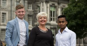 "Trinity graduates   Shane O'Connell, Carol Deans and Mansur Alam. It was ""tough, tough – boot camp for the brain"", but ""definitely worth it"", says Ms Deans. Photograph:  Paul Sharp/Sharppix"