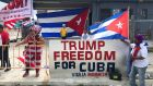 Ana Lacayo and Barbara Jimino, both of Miami, show their support for US president Donald Trump near the Manuel Artime Theater in Miami, Florida. Photograph: Bernie Woodall/Reuters