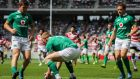 Ireland's Keith Earls scores the first try of the game. Photograph: Ryan Byrne/Inpho