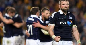 Scotland's captain John Barclay celebrates beating Australia in Sydney. Photograph: Getty Images