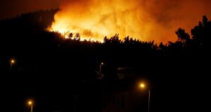 A forest fire is seen from the village of Bouca, near Pedrogao Grande, in central Portugal on Sunday. Photograph: Reuters