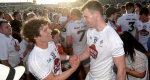Kildare's Chris Healy and Fionn Dowling celebrate after the game. Photograph: James Crombie/Inpho