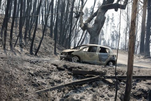 A burned car at N236 road between Figueiro dos Vinhos and Castanheira de Pera, Pedrogao Grande, central Portugal, 18 June 2017. At least sixty two people have been killed in forest fires in central Portugal, with many being trapped in their cars as flames swept over a road on the evening of 17 June 2017. EPA/PAULO NOVAIS