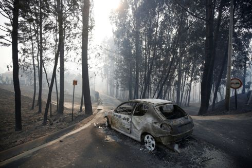 A burned car is seen in the aftermath of a forest fire near Pedrogao Grande, in central Portugal.  REUTERS/Rafael Marchante