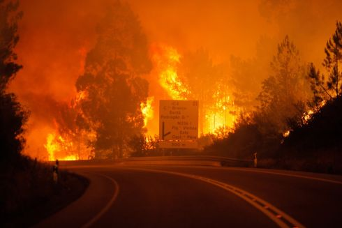 Flames rise during a forest fire in Pedrogao Grande, Leiria District, Center of Portugal. Photo:  EPA/PAULO CUNHA