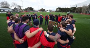British and Irish Lions team huddle with Warren Gatland during the training. Photograph: Billy Stickland/Inpho