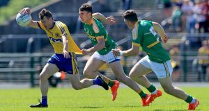 Roscommon's Conor Devaney with Dean McGovern and James Rooney of Leitrim in the Connacht senior football  semi-final at Dr Hyde Park. Photograph: INPHO/Donall Farmer