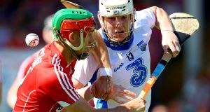 Cork's Stephen McDonnell vies with Waterford's Shane Bennett at  Semple Stadium yesterday. Photograph: Oisin Keniry/Inpho