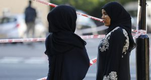 Two women watch proceedings at the security cordon at the scene in Finsbury Park. Photograph: Tolga Akmentolga/Getty Images