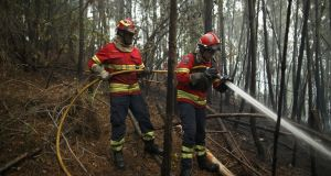 Firemen work on a forest fire after a wildfire took dozens of lives on June 19th. Photograph: Getty Images