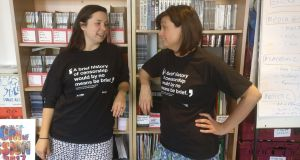 Index on Censorship staff wear a T-shirt with a Margaret Atwood quotation about censorship