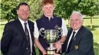 John Ferriter (Chairman Leinster Golf) presenting John Murphy (Kinsale) with the Leinster Students Amateur Open trophy after his victory at Newlands. Also in the picture is Newlands captain Paddy Butler. Photograph: Pat Cashman