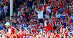 Cork fans celebrate a point during Sunday's win over Waterford. Photograph: Oisin Keniry/Inpho