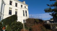 Number 1 The Crescent, Cobh, an end-of-terrace house, also has a good-sized private garden to the side