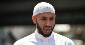 Mohammed Mahmud, the iman of the Muslim Welfare House, speaks to journalists about the van that was driven at worshippers in Finsbury Park, north London, Britain. Photograph: Hannah McKay/Reuters