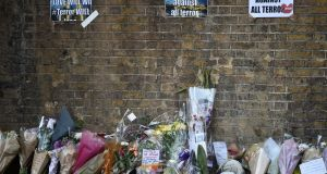 Messages and tributes are left near to where a van ploughed into worshippers outside a mosque in Finsbury Park, north London, Britain. Photograph: Hannah McKay/Reuters