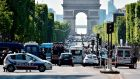 Police seal off Paris's Champs-Élysées avenue. Photograph: Alain Jocard/AFP/Getty Images