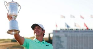 Brooks Koepka  celebrates with the trophy after winning the 117th US Open Championship at Erin Hills in Hartford, Wisconsin. Photograph: Erik S Lesser/EPA