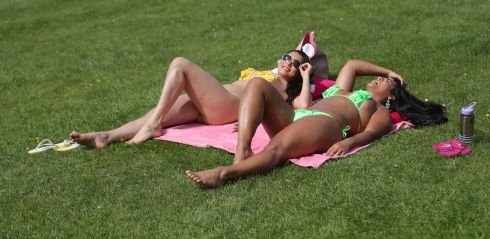 Sisters Thamy (left) and Mona Sant'Anna from Brazil enjoy the sun in Dublin's Phoenix Park. Photograph: Niall Carson/PA