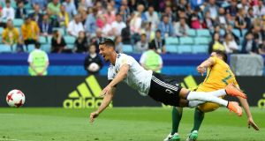 Germany's Sandro Wagner sends a header wide. Photograph: Kai Pfaffenbach/Reuters