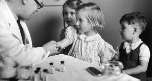 Children being inoculated against diphtheria in  1944. Photograph: Kurt Hutton/Picture Post/Hulton Archive/Getty Images
