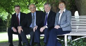 At the handover of the Dunadry Hotel were John Mooney, Felix Mooney, Eugene McKeever and Catherine McKeever.