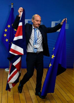 BREXIT TALKS: A clerk carries a Union Jack and a flag of the European Union at the European Commission HQ in Brussels on the day Britain started difficult Brexit talks to leave the EU with a badly weakened government. Photograph: Thierry Charlier/AFP/Getty Images