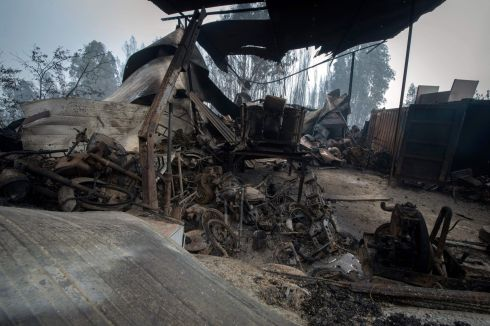 DEVASTATED BY FIRE: Wreckage of a garage in an area devastated by a wildfire close to the village of Figueiro dos Vinhos, central Portugal. At one stage more than 1,000 firefighters were trying to control the fires in the centre of the country. Photograph: Miguel Riopa/AFP/Getty Images