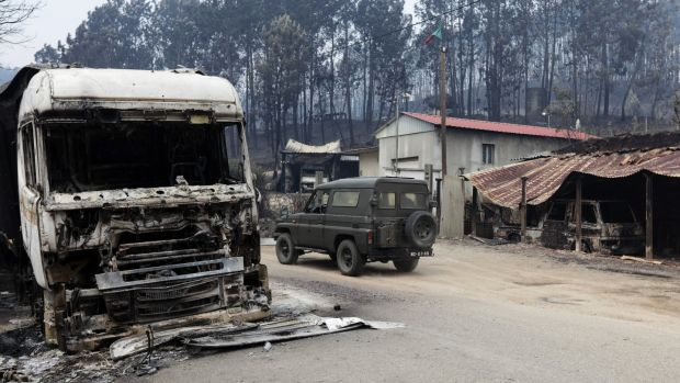 Military personnel arrive at the village of Vila Facaia to help recovery efforts in the aftermath of the forest fires, in Pedrógão Grande, Portugal. Photograph: Paulo Novais/EPA