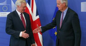 United Kingdom secretary of state for exiting the European Union David Davis is welcomed by Michel Barnier, the European chief negotiator of the Task Force for the Preparation and Conduct of the Negotiations with the United Kingdom. Photograph: Stephanie Lecocq