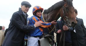 Aidan O'Brien and Ryan Moore after victory with Churchill in the Tattersalls Irish 2,000 Guineas at the Curragh. Photograph: Lorraine O'Sullivan/Inpho