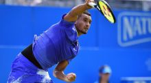 Australia's Nick Kyrgios suffered a hip injury after a fall on court during his first round match against  Donald Young at the ATP Aegon Championships at Queen's Club in  London.  Photograph: Glyn Kirk/AFP/Getty